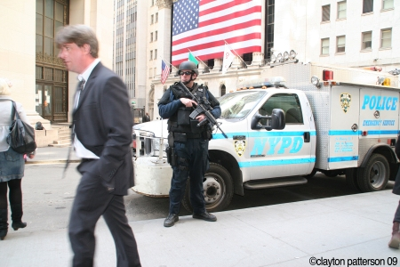 Sweating on Wall Street- who is cop watching or protecting- me or the suit?